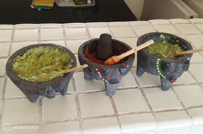 Molcajetes filled with guacamole and salsa